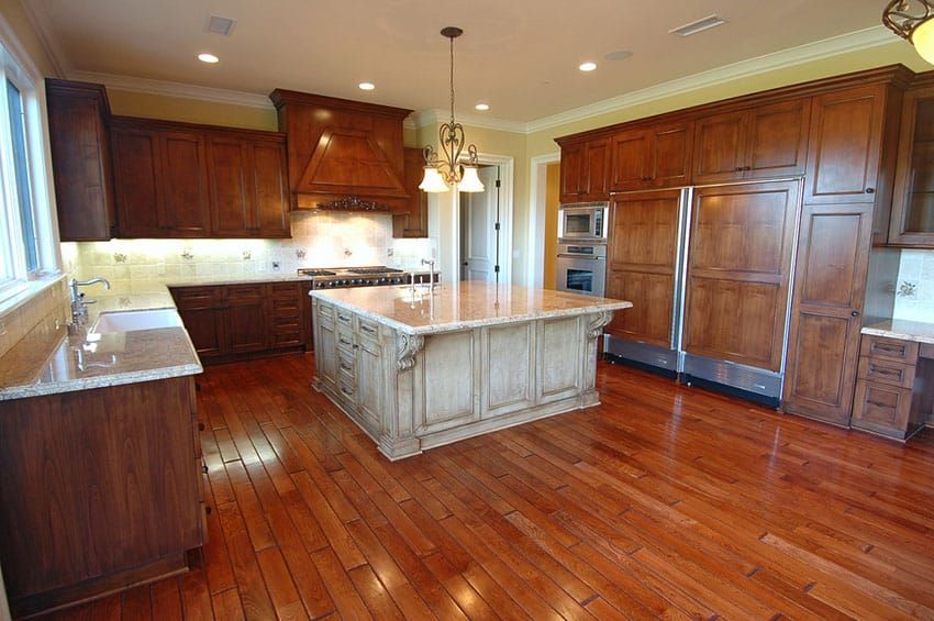 Luxury wood kitchen with large center island in lighter color