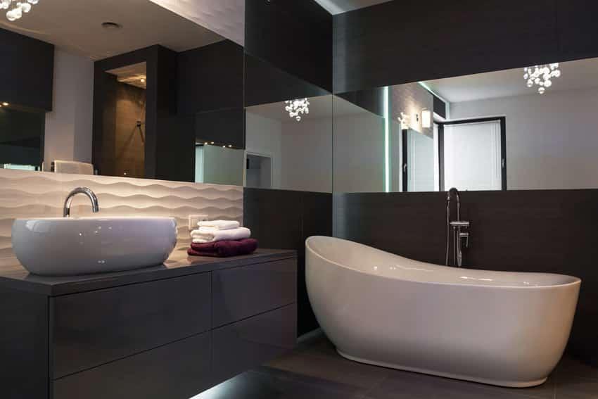 Mirrored bathroom interior with bathtub