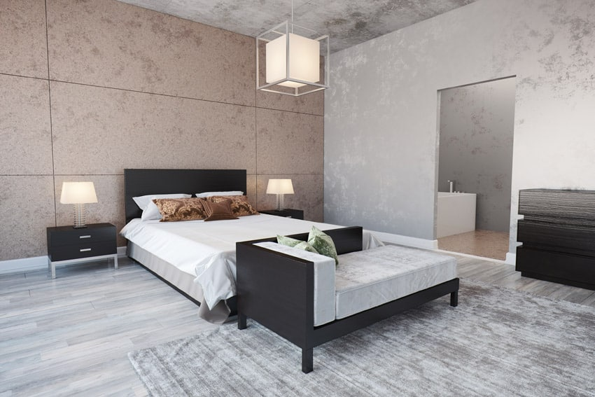 Modern bedroom design with concrete surfaces