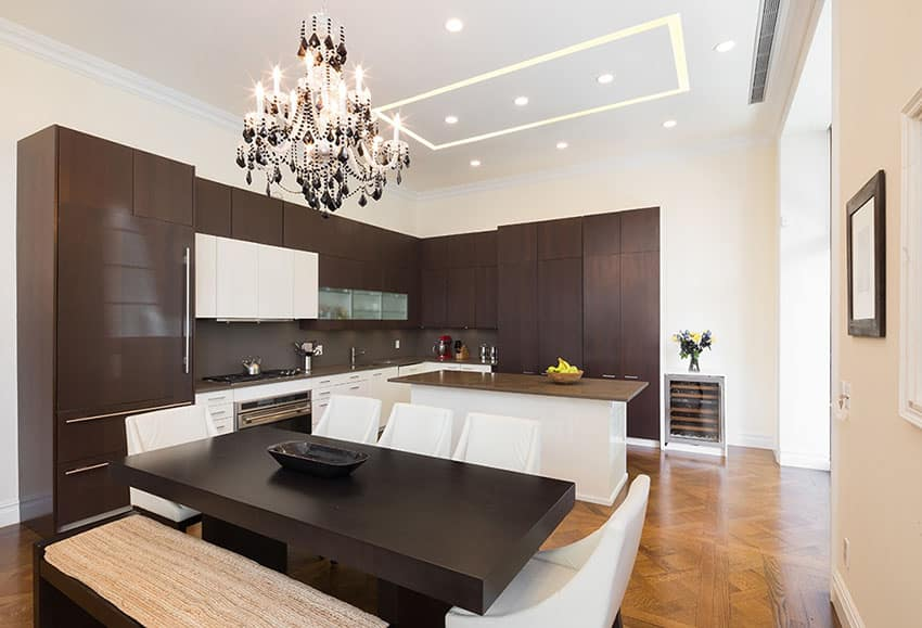 Modern dark cabinet wood kitchen with white island and cabinetry