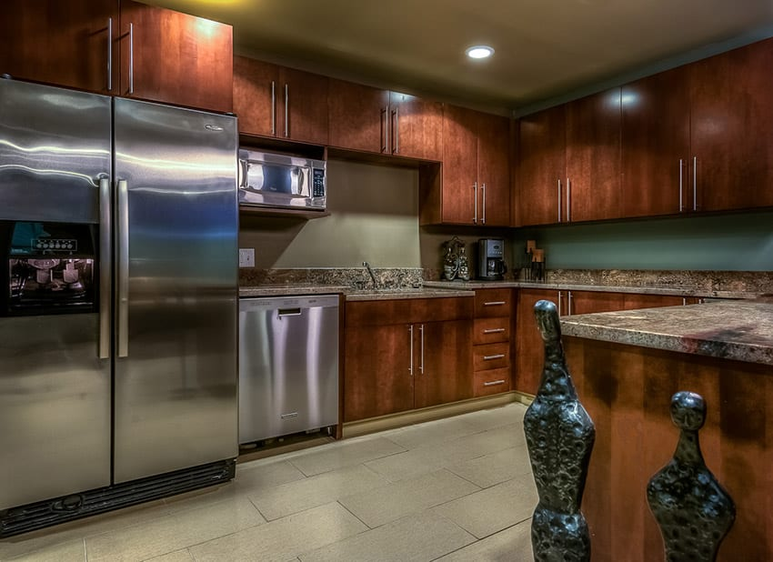 Polished wood cabinet kitchen with thick slab granite beige color