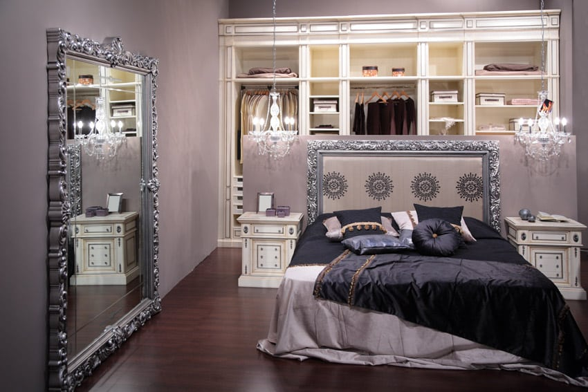 Purple bedroom with large silver mirror