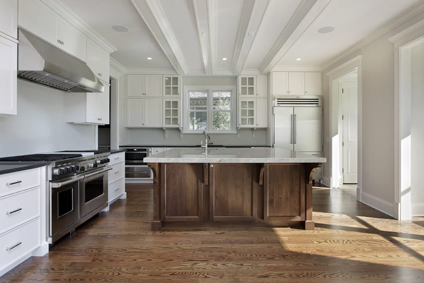 Upscale white kitchen with traditional style