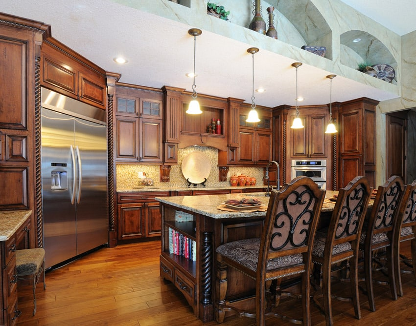 Upscale wood kitchen with pendant lights