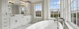 white-marble-bathroom-with-great-lighting-and-windows