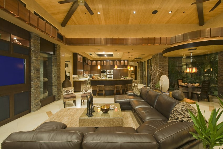 Comfortable living room in luxury home with large leather sectional sofa