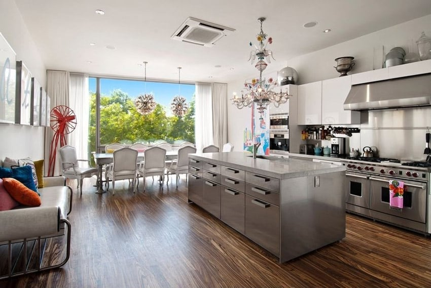 Contemporary kitchen with chandelier stainless island