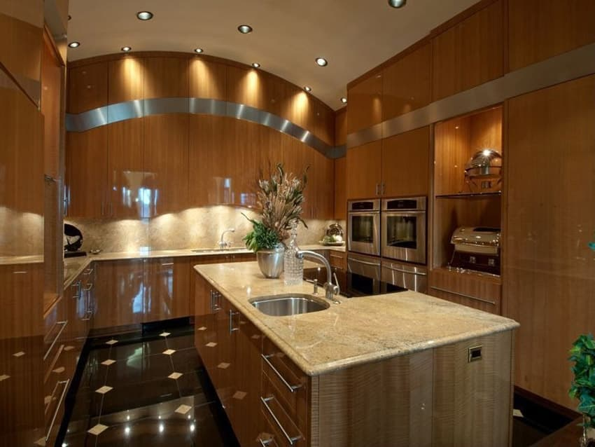 Contemporary kitchen with rich wood cabinets black granite counters
