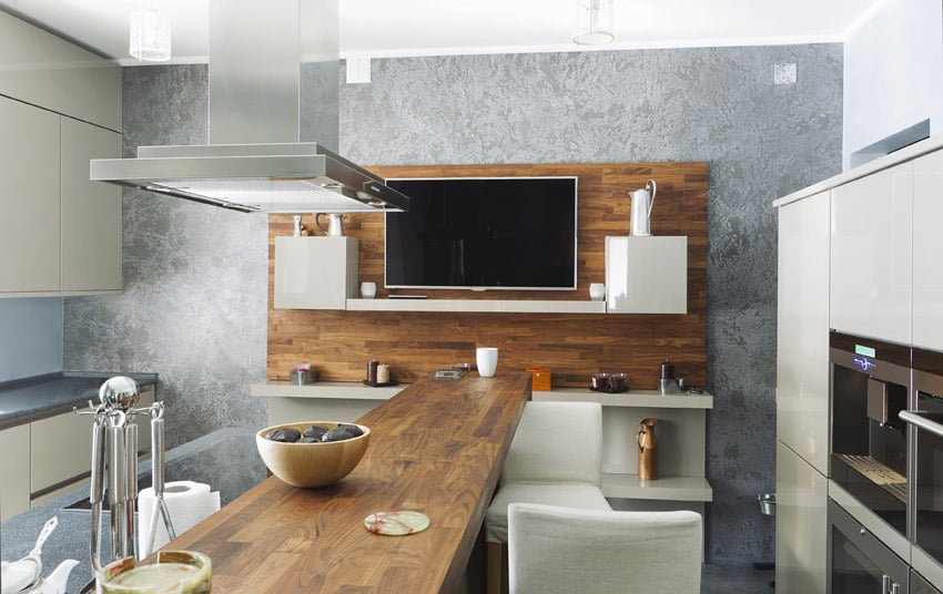 Interesting modern kitchen with long narrow island
