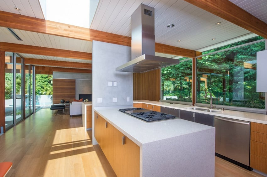 Kitchen with view of garden and wood cabinets with white counters
