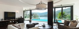 living-room-with-pool-view-and-circular-tray-ceiling