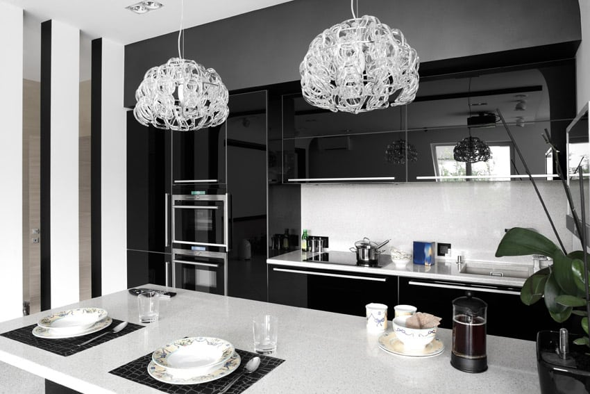 Modern kitchen with dual chandeliers