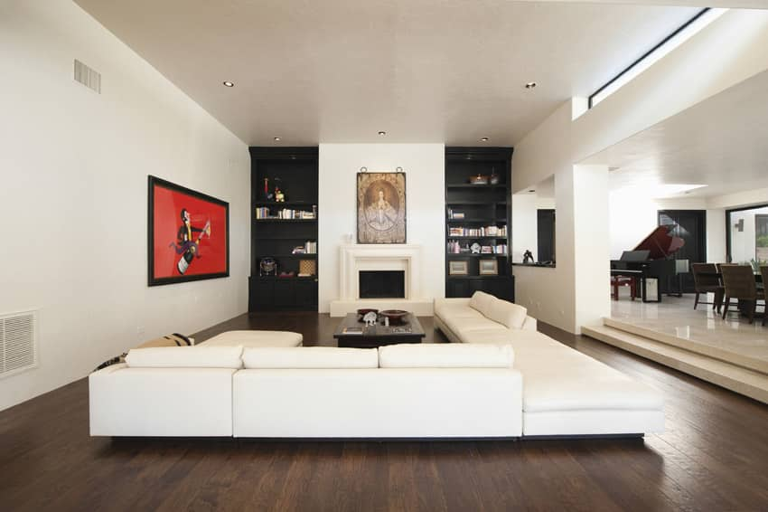Modern white themed living room with black built-in-shelving