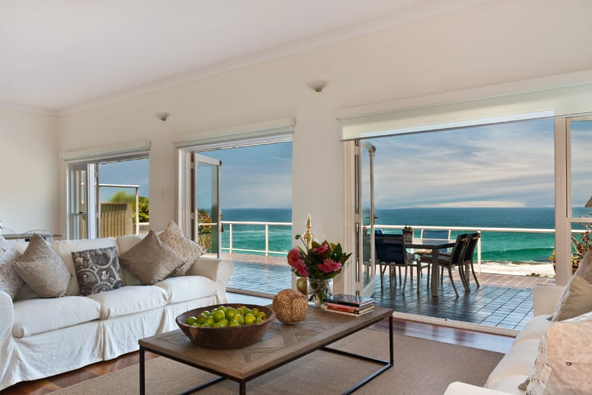 Oceanfront living room with wood flooring and view of water