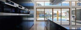 sleek-black-modern-kitchen-with-view
