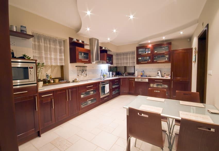 Spacious modern kitchen with brown white theme