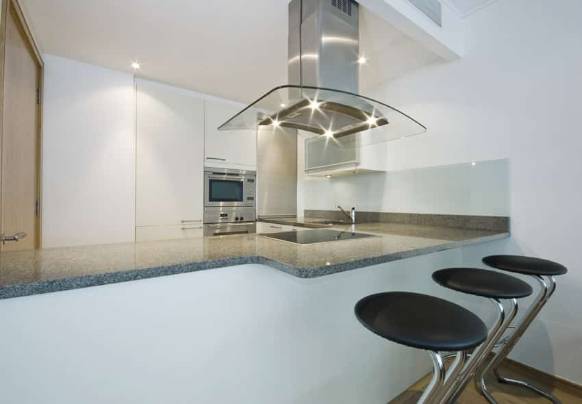 Ultra modern kitchen with stainless and glass oven hood