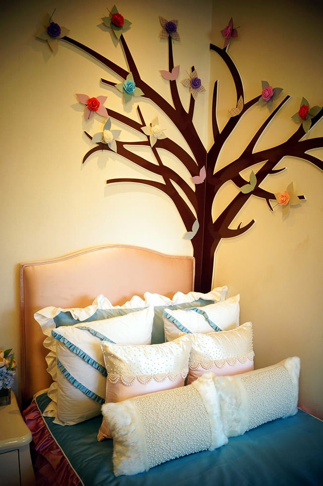Child's bedroom with wall art of tree
