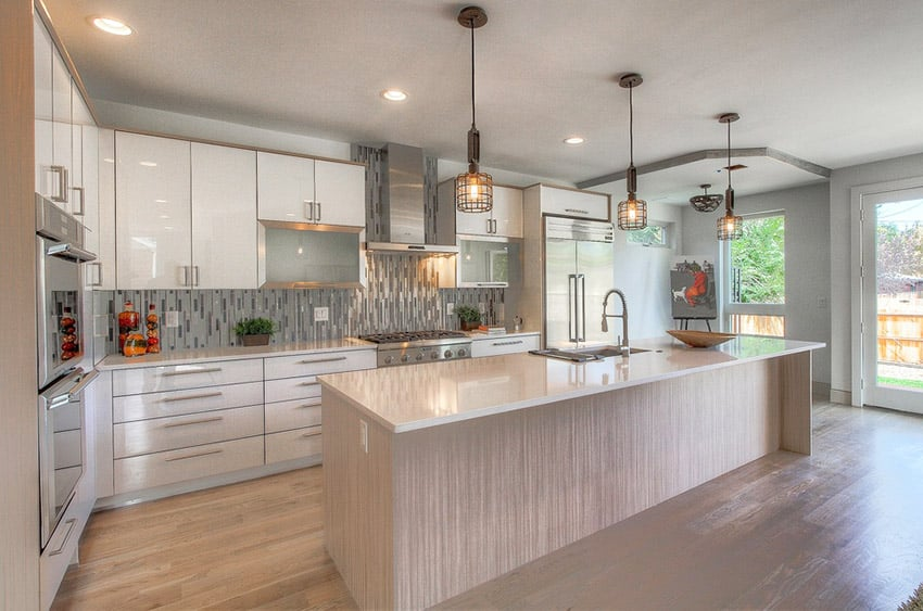 Kitchen With Glass Backsplash Pendant Lighting And Light Color