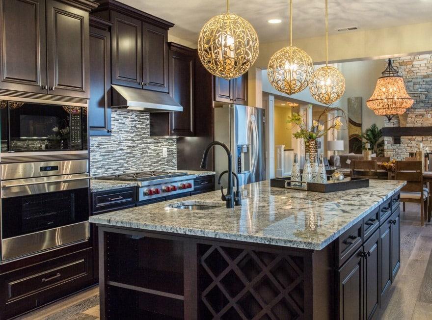 Dark cabinet kitchen with globe lighting