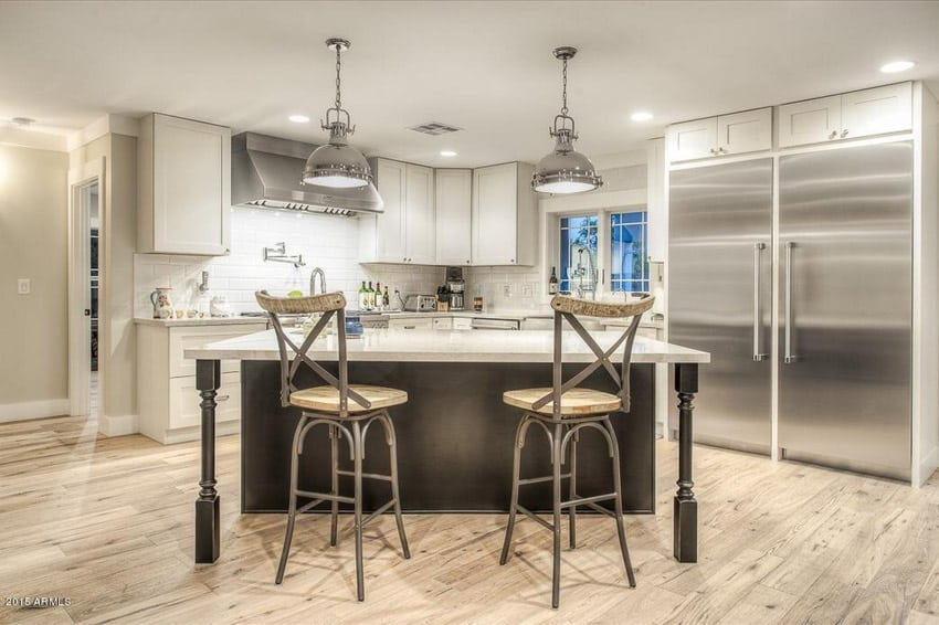 is an open concept modern kitchen with a very unique kitchen island