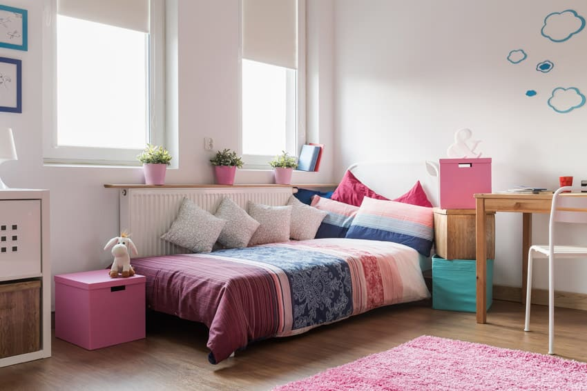 Day bed in girls room with wood floors and desk