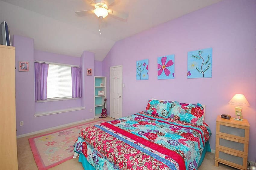 Fun and bright girls bedroom with purple walls