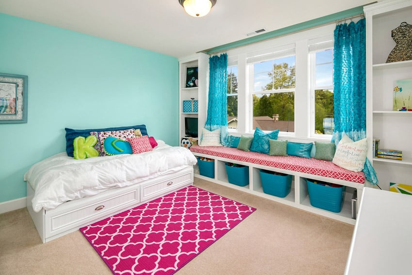 Girls bedroom with basket storage area