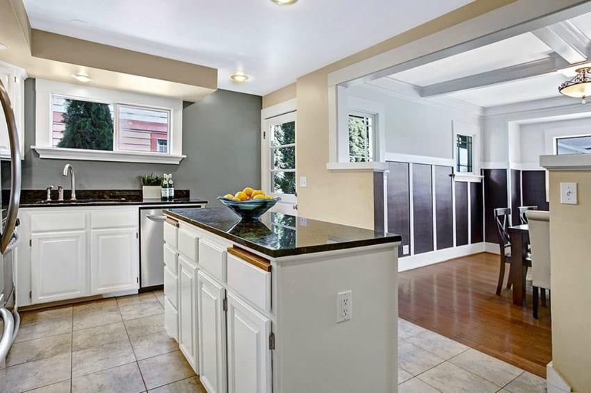 white kitchen cabinets with black granite countertops use arrow keys
