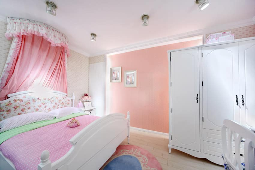 Little girls lovely bedroom with large wardrobe