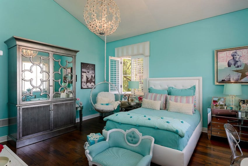 Luxury girls bedroom with chandelier and turquoise decor
