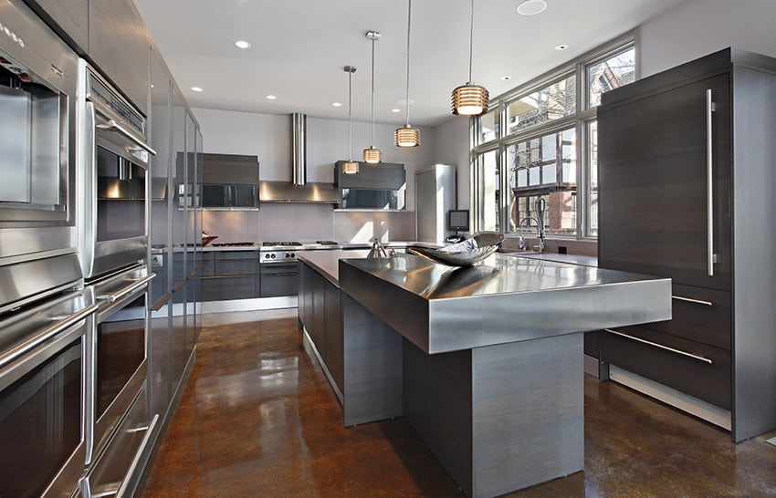 Modern kitchen with stainless steel counter and concrete flooring
