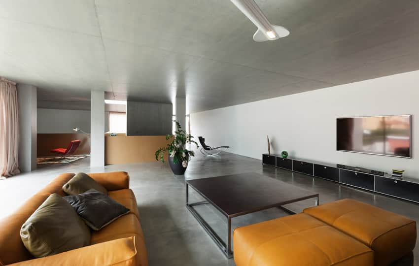 Modern living design with orange leather furniture