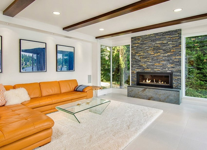 Modern living room with large fireplace and exposed wood beamed ceiling