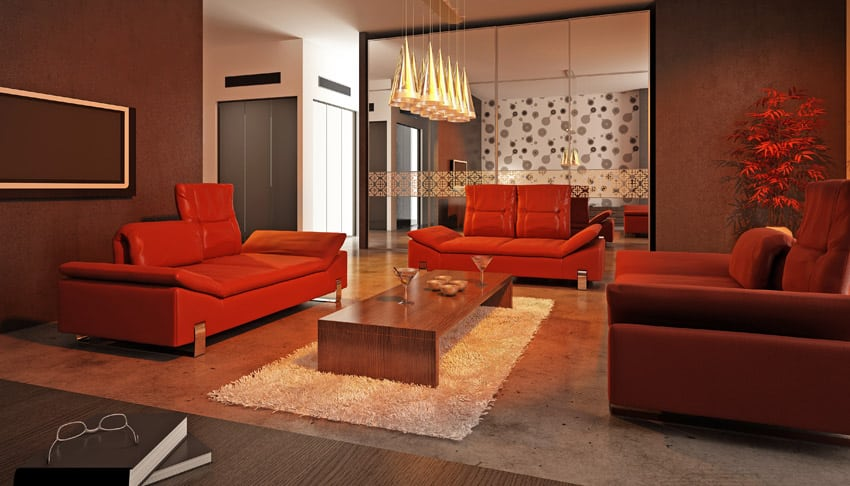 Modern living space with red furniture