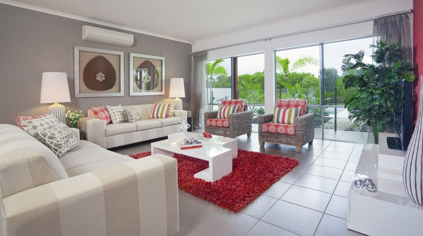 Modern living space with backyard view and red shag area rug