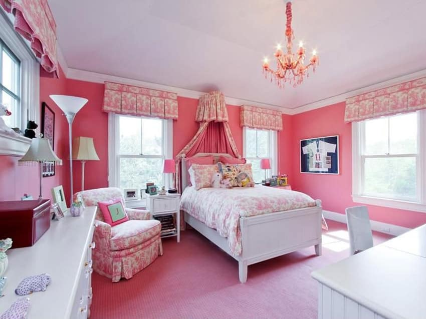 Pink bedroom with decorative chandelier