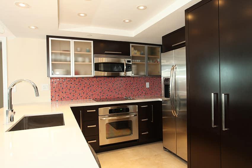 Small modern kitchen with mosaic tile backsplash