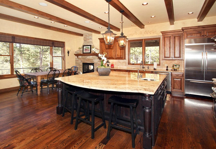 Traditional open plan layout kitchen rustic wood exposed beams