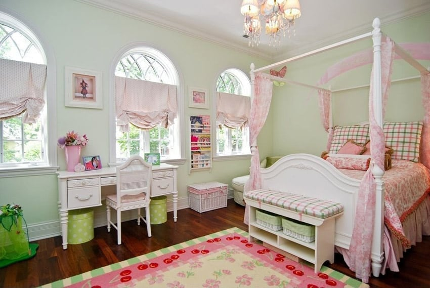 Pretty furnished girls room with four post bed