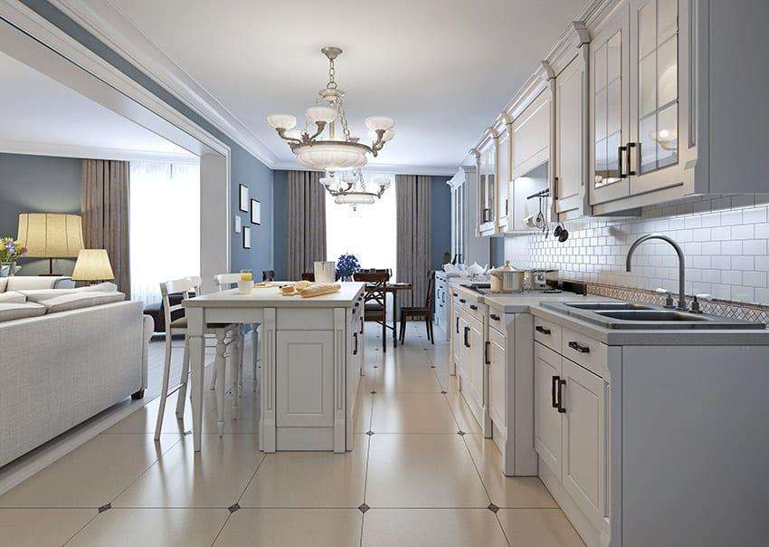 White single line kitchen with island and white brick backsplash