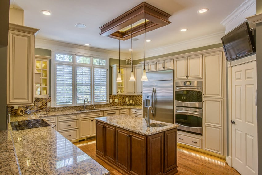 Wood kitchen island with gold granite