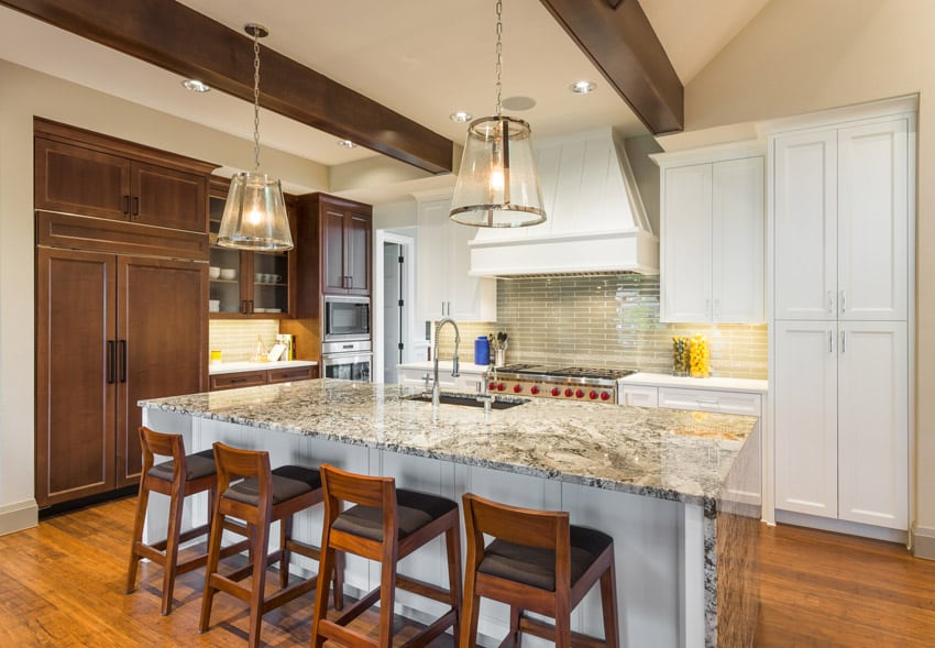Classic style kitchen with dining island and exposed wood beams