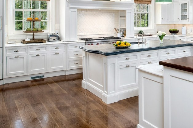 Contemporary kitchen with dark wood flooring