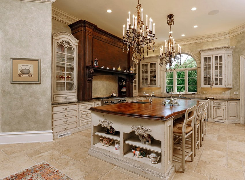 Elegant kitchen with custom wood countertops and chandeliers