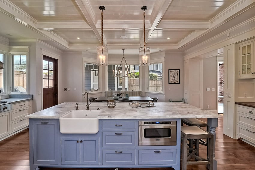 Kitchen with carrara marble counters light blue color island