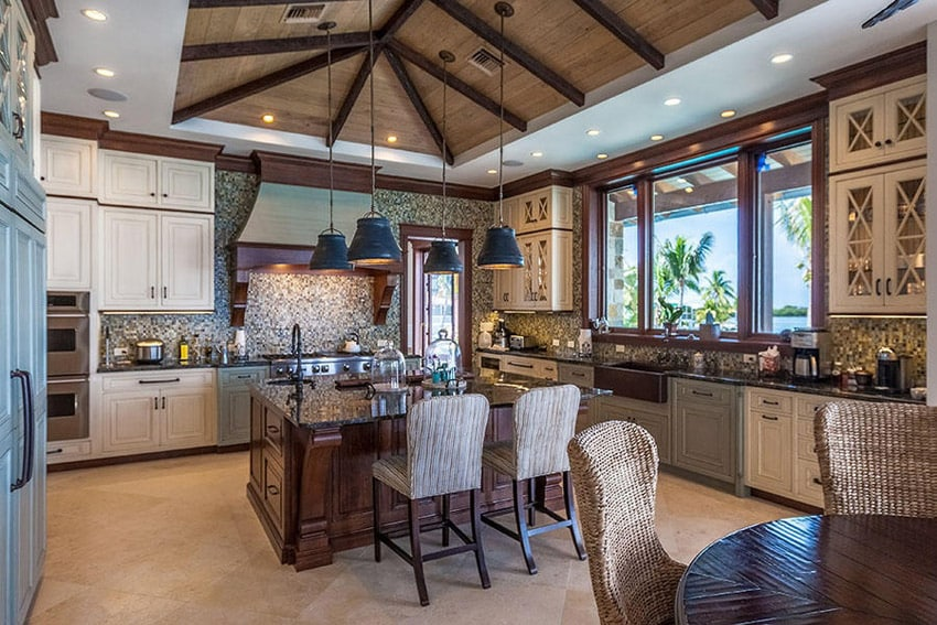 Luxury kitchen with limestone tile flooring vaulted ceilings