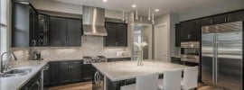 kitchen-with-luxury-finishes-mosaic-tile-backsplash-large-dining-island