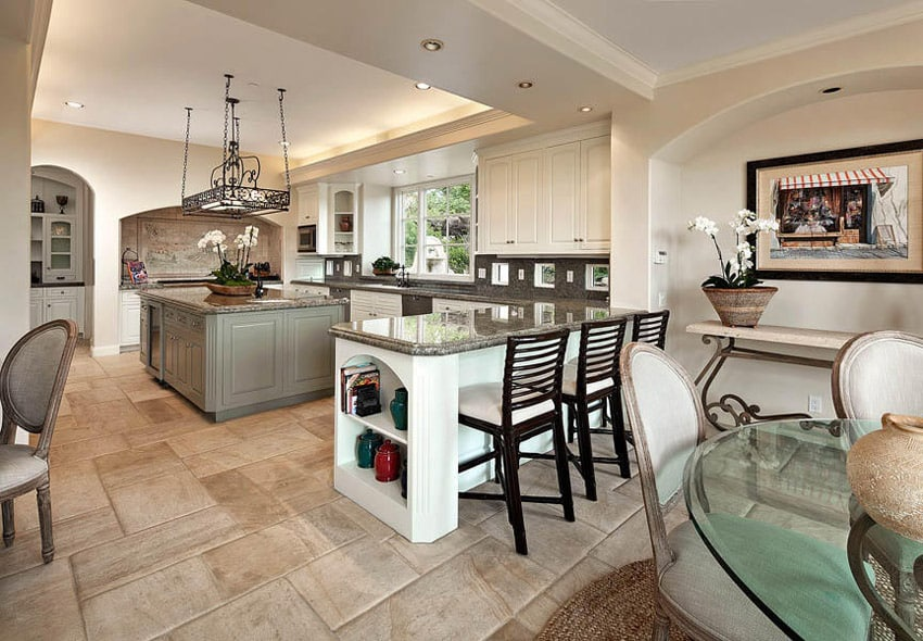 Kitchen with partial open plan design and white cabinets with an sage green island