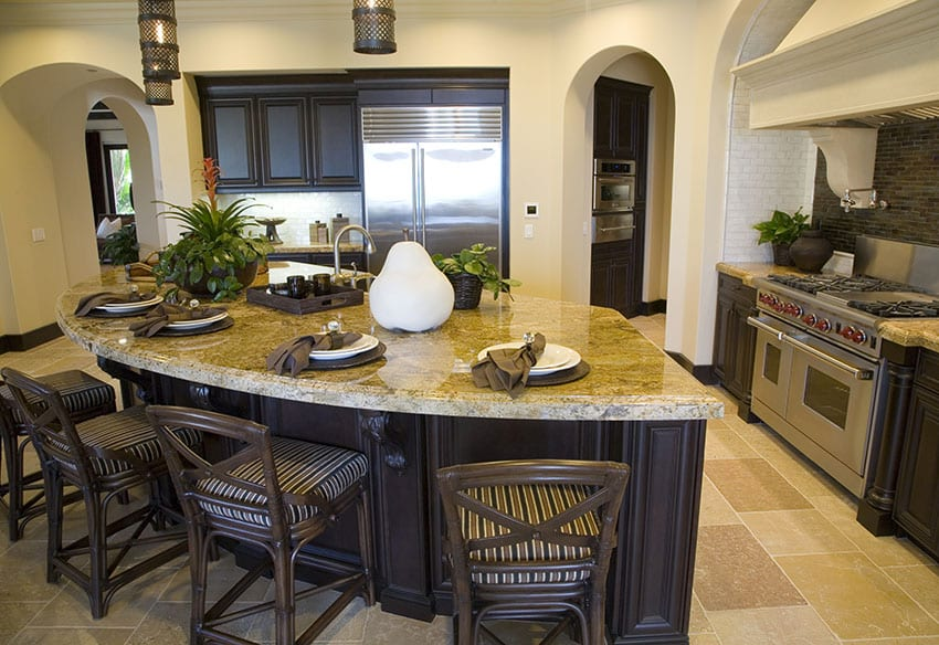 Kitchen with yellow granite counters and curved eat in island